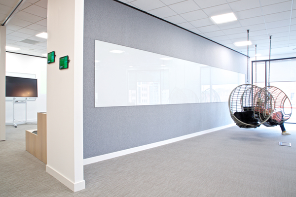 Full acoustic wall covering plus a long drywipe with trim to all edges